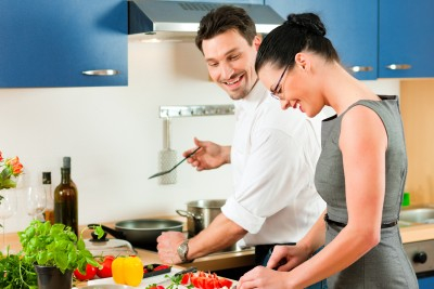 Man-and-Woman-Cooking-in-Kitchen