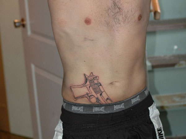 MAINE MAN'S 'GUN' TURNS OUT TO BE A TATTOO